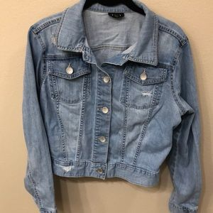 Light wash denim jacket distressed